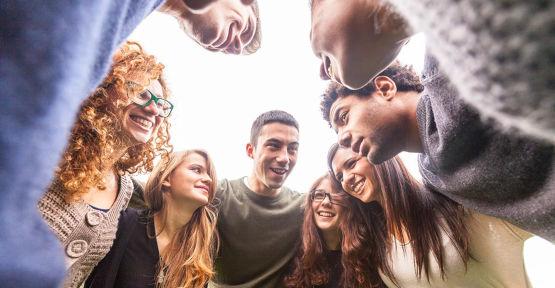 Group hug with young people