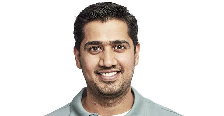 Hindi man in green shirt