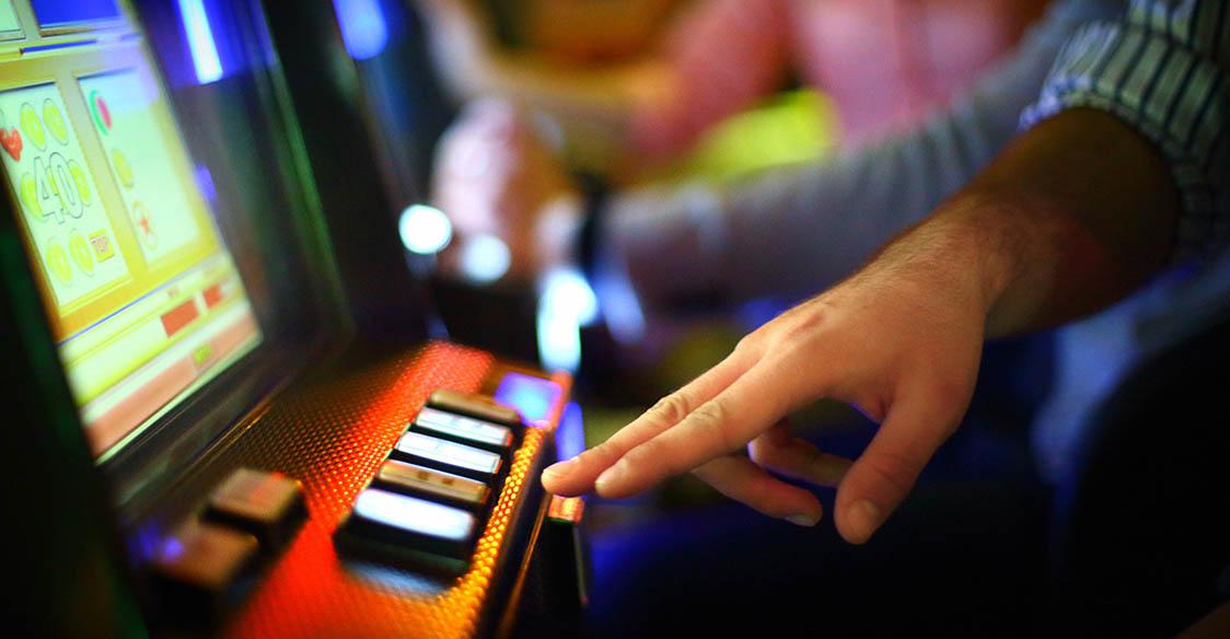 Hand on poker machine