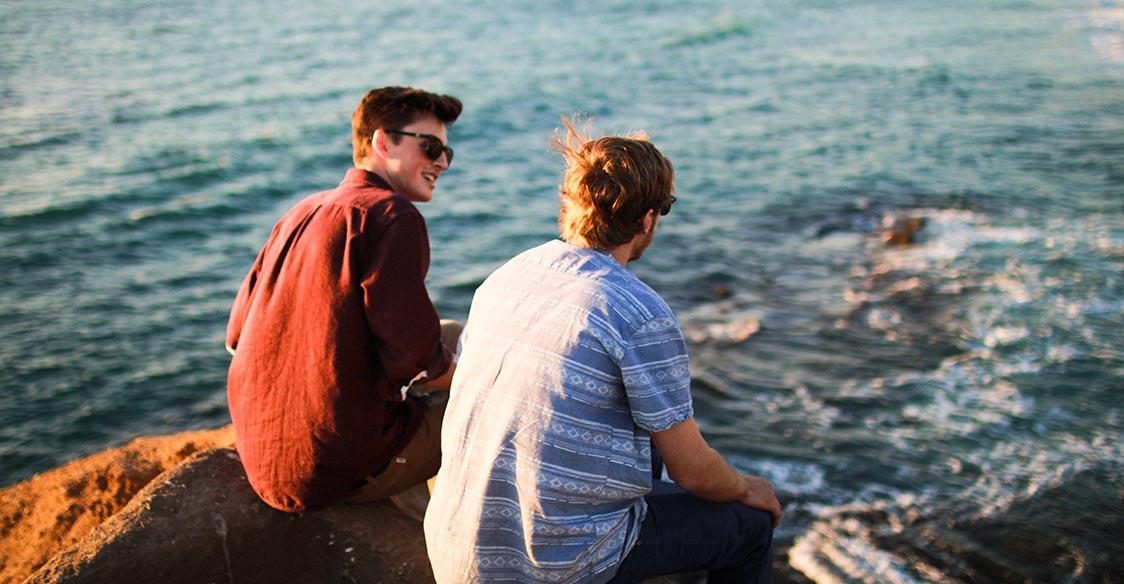 Friends talking near the ocean