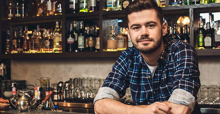 Young man behind bar