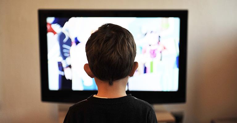 Young boy watching screen