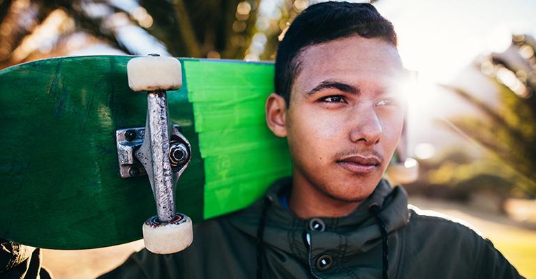 Boy with green skateboard